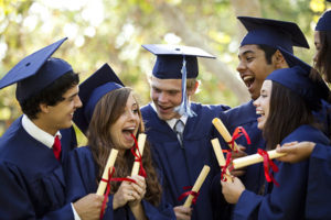 High School Graduation robe colours in Australia. Happy high school students with their graduation attire